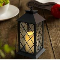 China Vintage Indoor Black Lantern Flameless LED Candles With Plastic Wavy Portable Iron Hanging Lamp Lantern With Battery on sale