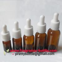China amber boston round glass dropper bottle w/ tamper evident closures on sale